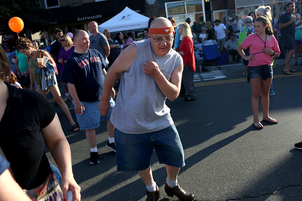HADLEY GREEN/ Staff photo<br /> John Berte of Beverly tap dances to the music at Oldies Night in Danvers Square. 6/28/17
