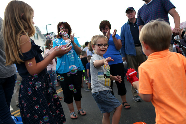 HADLEY GREEN/ Staff photo<br /> Colton Wright, of Danvers, sprays Ryan Colombino, also of Danvers, with bubbles at Oldies Night in Danvers Square. 6/28/17