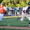 HADLEY GREEN/ Staff photo<br /> Danvers' Anthony Olszak (11) runs to first base as Woburn pitcher Danny Haverty (4) throws to first at the Danvers v. Woburn Division 2 North first round state tournament boys baseball game held at the Twi Field in Danvers. 6/01/17