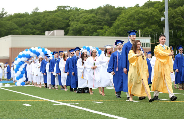 HADLEY GREEN/ Staff photo<br /> Graduates walk into the Danvers High School graduation ceremony at Danvers High. 6/10/17