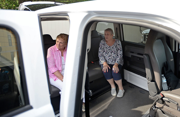 RYAN HUTTON/ Staff photo<br /> Jackie Torigian, left, and Natalie Maga, right, check out one of the Peabody Council on Aging's new MV-1 in the parking lot of the Torigian Senior Center on Tuesday. The MV-1 is one of the new vehicles purchased with the help of the state Department of Transportation's Mobility Assistance Grant.