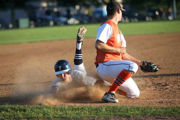 HADLEY GREEN/ Staff photo<br /> Danvers' Jordan DeDonato (13) slides safely into third base at the Danvers v. Woburn Division 2 North first round state tournament boys baseball game held at the Twi Field in Danvers. 6/01/17
