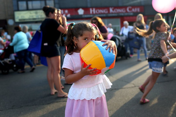 HADLEY GREEN/ Staff photo<br /> Elza Encarnacion, 5, blows up a beach ball at Oldies Night in Danvers Square. 6/28/17