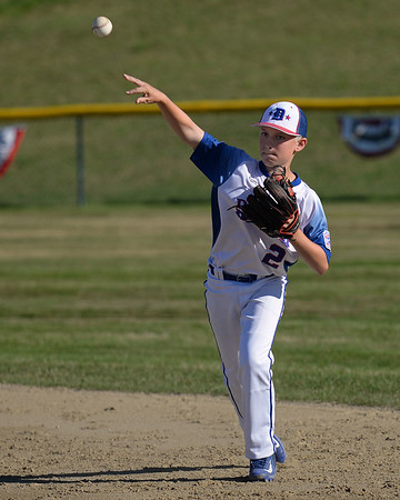 RYAN HUTTON/ Staff photo<br /> Danvers' Will McEnaney throws the ball in after fielding it just outside the infield during the top of the first inning of Wednesday's game against Gloucester at Boudreau Field in Gloucester.