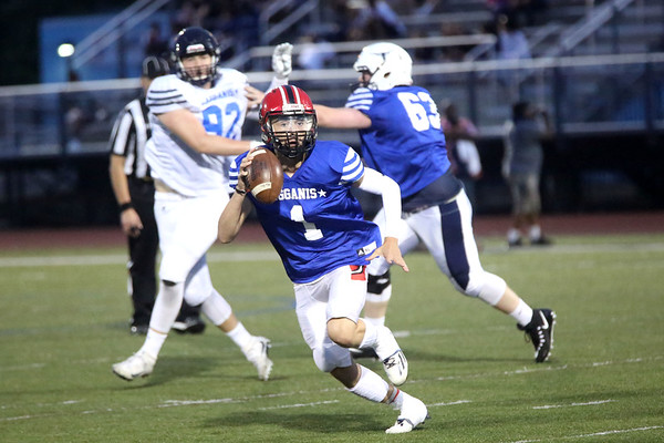 HADLEY GREEN/ Staff photo<br /> North's Jared Lubas (1) of Salem runs up the field at the Agganis boys football all-star game at the Manning Field in Lynn. 6/28/17