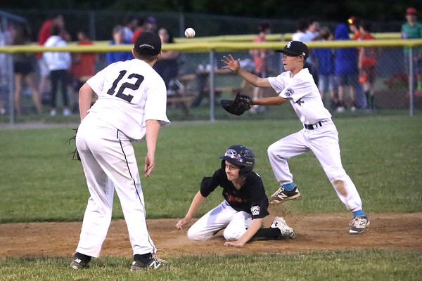HADLEY GREEN/ Staff photo<br /> White Sox pitcher Max Salerno (12) throws the ball to Bradley McApline (2) while Giants' Riley McGoldrick (10) slides into second at the White Sox v. Giants Beverly Little League championship game at the Harry Ball Field. 6/21/17