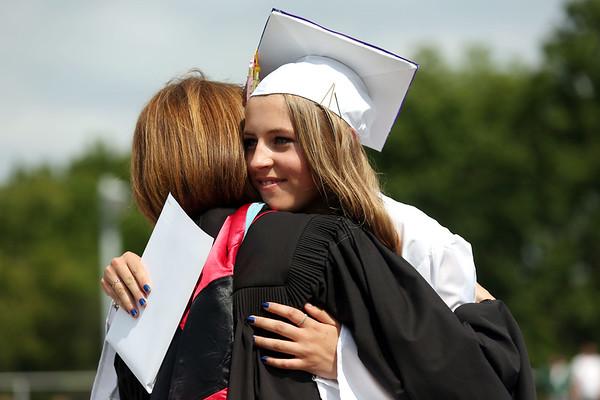 HADLEY GREEN/ Staff photo<br /> Graduating senior Katie Crum hugs school principal Susan Ambrozavitch after receiving her diploma. 6/10/17
