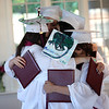 HADLEY GREEN/ Staff photo<br /> The five graduating seniors of The Academy at Penguin Hall's inaugural class hug after receiving their diplomas. 6/09/17