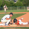 HADLEY GREEN/ Staff photo<br /> Danvers' Zach Dillon (18) tags Woburn's Kevin Vasapolli (10) as he slides back to first at the Danvers v. Woburn Division 2 North first round state tournament boys baseball game held at the Twi Field in Danvers. 6/01/17