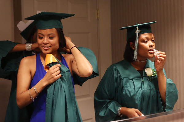 HADLEY GREEN/ Staff photo<br /> Alexus Parker, right, and Genesis Gonzalez, left, prep in the mirror before they graduate from Salem Academy Charter School. The ceremony was held at the Salem Waterfront Hotel. 6/16/17