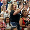 HADLEY GREEN/ Staff photo<br /> Families and friends spot their graduates at the Salem High School graduation ceremony at the Salem High field house. 6/02/17
