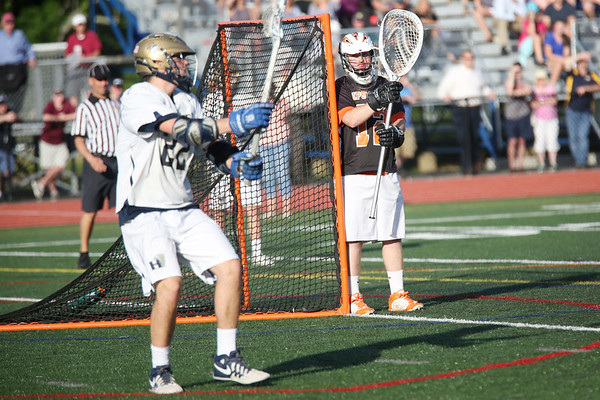 HADLEY GREEN/ Staff photo<br /> Ipswich's goalie Aidan McAdams (12) stands guard in goal at the Ipswich v. Hanover boys lacrosse Division 3 state semifinals game at Norwell High School in Norwell, Massachusetts. 6/14/17