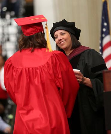 HADLEY GREEN/ Staff photo<br /> Salem Mayor Kim Driscoll presents diplomas to graduating members of the Salem High School senior class. 6/02/17