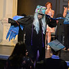 RYAN HUTTON/ Staff photo<br /> New Liberty Innovation School graduate Camilla Paille shows off her blue wings as she returns to her seat after giving a speech at the school's graduation ceremony at the Salem YMCA's Ames Hall on Thursday.