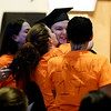 "RYAN HUTTON/ Staff photo<br /> New Liberty Innovation School graduate Heather Larivee receives hugs and kisses from friends wearing home-made ""Team Heather"" shirts after getting her diploma at the school's graduation ceremony at the Salem YMCA's Ames Hall on Thursday"