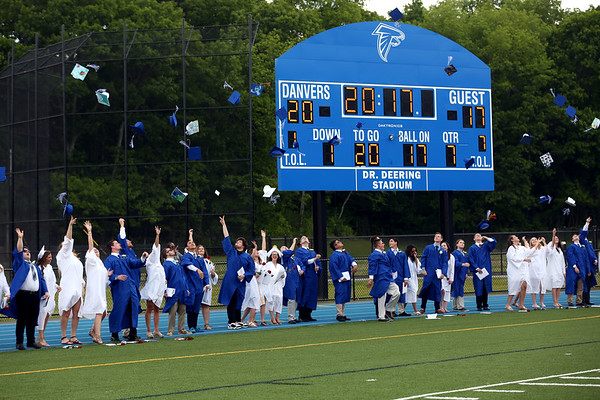HADLEY GREEN/ Staff photo<br /> Graduates throw up their caps in celebration at the end of the ceremony. 6/10/17