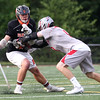 HADLEY GREEN/ Staff photo<br /> Beverly's Chris Cole (10) and Wakefield's Patrick Leary (9) vie for the ball at the Wakefield v. Beverly Division 2 North championship boys lacrosse game held at Concord-Carlisle High School in Concord. 6/10/17