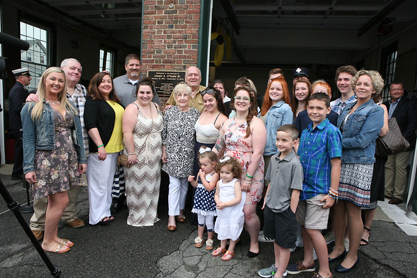 AMY SWEENEY/Staff photo. Family of late Joseph A. O'Keefe, Sr., gather around the fire station that was dedicated in his honor. The building that houses Salem Fire Engine 5 was dedicated to Joseph O'Keefe, a beloved city official who died in September 2015. He had a long and celebrated tenure on City Council. O'Keefe also served as state fire marshal from 1977 to 1992. <br /> June 17, 2017.