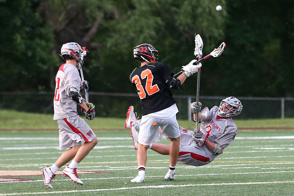HADLEY GREEN/ Staff photo<br /> Beverly's Tom Adams (32) fights for the ball with Wakefield's Nolan Collins (12) and Ryan Fitzpatrick (3) at the Wakefield v. Beverly Division 2 North championship boys lacrosse game held at Concord-Carlisle High School in Concord. 6/10/17