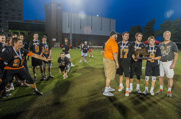 Ipswich coaches and captains accept the MIAA division three championship trophy.