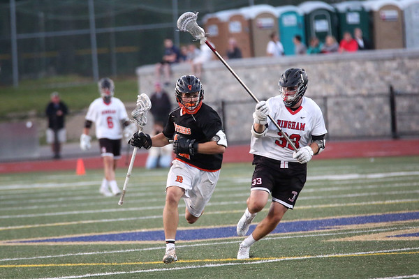 HADLEY GREEN/ Staff photo<br /> Beverly's Kyle Chouinard (2) runs with the ball while Hingham's John Mills (3) plays defense at the Hingham v. Beverly boys lacrosse Division 2 state semifinals game at Norwell High School in Norwell, Massachusetts. 6/14/17