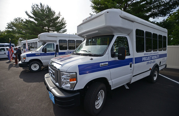 RYAN HUTTON/ Staff photo<br /> A pair of new vans sits in the parking lot of Peabody's Torigian Senior Center on Thursday. The new vehicles were purchased with the help of the state Department of Transportation's  Mobility Assistance Grant.