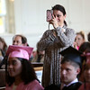 HADLEY GREEN/ Staff photo<br /> Lana Bron of Swampscott takes a photo while her daughter, Marina Bron, speaks to her class at the Northshore Recovery High School graduation ceremony held at the Second Congregational Church in Beverly. 6/07/17