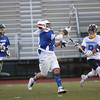 HADLEY GREEN/ Staff photo<br /> North's Eddie Sullivan (2) moves the ball while South's Anthony DelVeccio (9) plays defense at the Agganis boys lacrosse all-star game at the Manning Field in Lynn. 6/28/17
