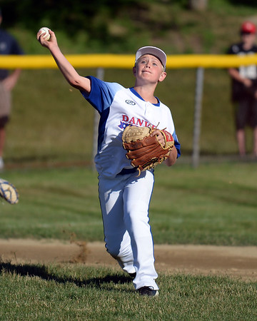 RYAN HUTTON/ Staff photo<br />  Danvers' Jonathan DiTomaso makes the throw to first during the top of the first inning of Wednesday's game against Gloucester at Boudreau Field in Gloucester.