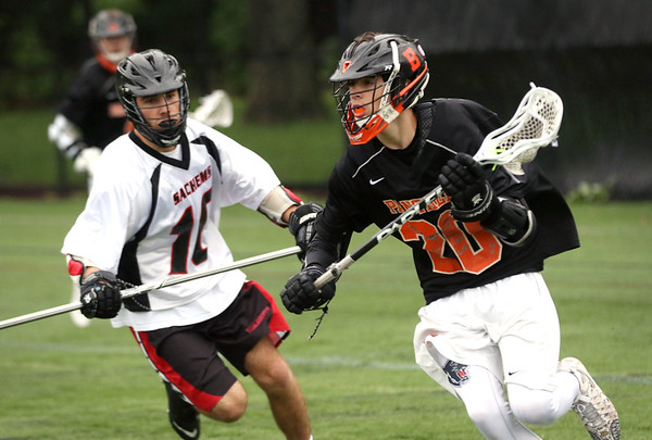 HADLEY GREEN/ Staff photo<br /> Beverly's Matt Rawding (20) runs with the ball while Winchester's Max Ehrbar (10) plays defense at the Winchester v. Beverly Division 2 North semifinals boys lacrosse game at Knowlton Field in Winchester. 6/06/17