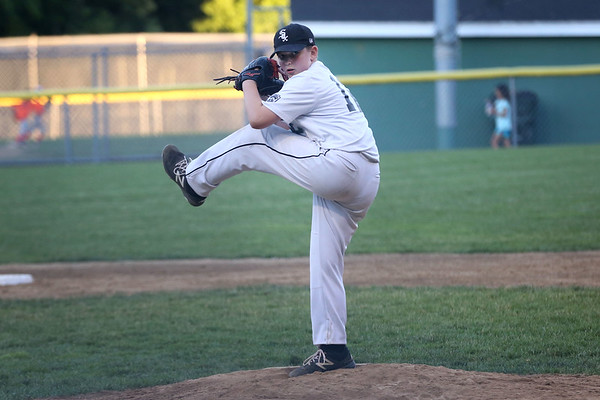 HADLEY GREEN/ Staff photo<br /> White Sox pitcher Max Salerno (12) winds up at the White Sox v. Giants Beverly Little League championship game at the Harry Ball Field. 6/21/17