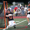 HADLEY GREEN/ Staff photo<br /> Beverly goalie Kevin Morency (17) makes a save during the Hingham v. Beverly boys lacrosse Division 2 state semifinals game at Norwell High School in Norwell, Massachusetts. 6/14/17