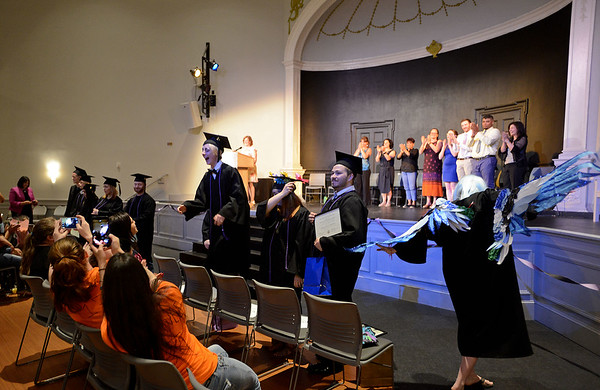 RYAN HUTTON/ Staff photo<br /> Members of the New Innovation School's Class of 2017 receive a round of applause after getting their diplomas at the school's graduation ceremony at the Salem YMCA's Ames Hall on Thursday.