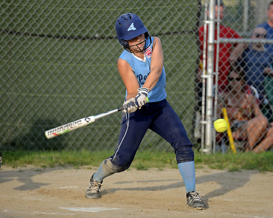 RYAN HUTTON/ Staff photo<br /> Peabody's Isabel Bettencourt swings away at a pitch in the bottom of the fourth inning of Thursday's game against Woburn at the Lt. Ross Park.