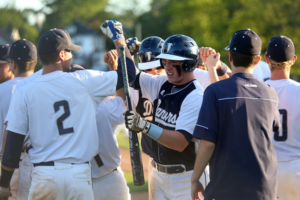 HADLEY GREEN/ Staff photo<br /> Danvers' Matt Andreas (10), center, bumps fists with his teammates after scoring at the Danvers v. Woburn Division 2 North first round state tournament baseball game held at the Twi Field in Danvers. 6/01/17