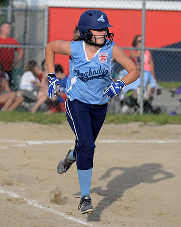 RYAN HUTTON/ Staff photo<br /> Peabody's Emma Bloom hustles to first in the bottom of the third inning of Thursday's game against Woburn at the Lt. Ross Park.