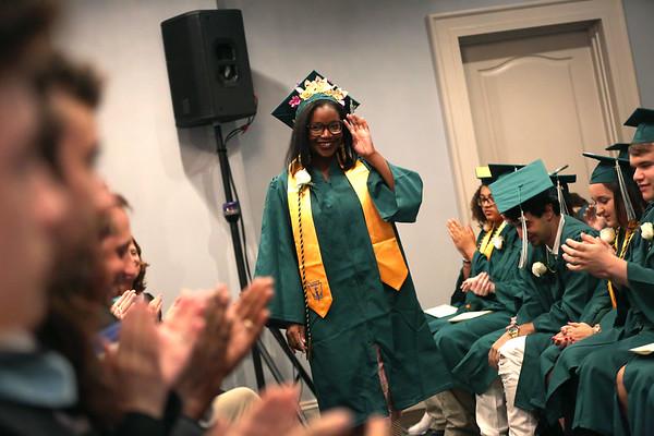 HADLEY GREEN/ Staff photo<br /> Class valedictorian Sia-Linda Lebbie walks to the podium to address her class at the Salem Academy Charter School graduation ceremony. 6/16/17