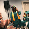 HADLEY GREEN/ Staff photo<br /> Class valedictorian Sia-Linda Lebbie walks to the podium to address her class at the Salem Academy Charter School graduation ceremony. 6/16/17