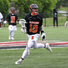 HADLEY GREEN/ Staff photo<br /> Beverly's Chris Cole (10) runs near the goal at the Winchester v. Beverly Division 2 North semifinals boys lacrosse game at Knowlton Field in Winchester. 6/06/17