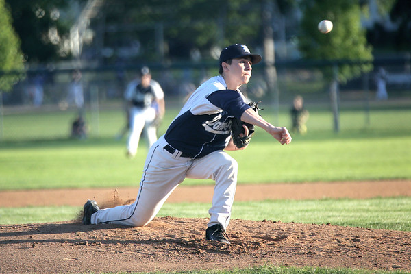 HADLEY GREEN/ Staff photo<br /> Danvers pitcher Justin Roberto (12) pitches at the Danvers v. Woburn Division 2 North first round state tournament baseball game held at the Twi Field in Danvers. 6/01/17