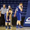 Danvers senior captains Mark McCarthy (3) and Kieran Beck (12) can't bear to watch New Mission celebrate their 60-51 win over the Falcons in the D2 North Final on Saturday afternoon. DAVID LE/Staff photo 3/8/14