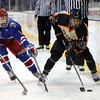 Beverly senior forward Ryan Santo (11) controls the puck behind the net against Tewksbury junior forward Ryan Petti (8) during the D2 North Final at the Tsongas Center at UMass Lowell on Monday evening. DAVID LE/Staff photo 3/10/14