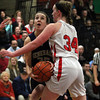 Hamilton-Wenham senior captain Sam Charette (35) drives to the hoop while being defended by Watertown's Fran Konte (34) during the first half of play on Thursday evening. DAVID LE/Staff photo 3/6/14