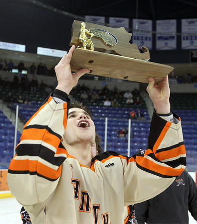 Beverly senior Ryan Santo kisses the D2 North Championship trophy after the Panthers captured their first D2 North crown with a dominating victory over Tewksbury 9-1 to advance to the D2 State Final to be played next Sunday at the TD Garden where the Panthers will take on South Division Champion Medfield. DAVID LE/Staff photo 3/10/14
