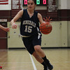 Hamilton-Wenham senior captain Sue Rose (15) drives to the hoop against Watertown in the D2 North Semifinal at Chelmsford High School on Thursday evening. DAVID LE/Staff photo 3/6/14