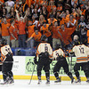 The Beverly High School fan section goes crazy after senior captain Connor Irving's hat trick goal during the second period of play. Irving scored four goals and added an assist in a 9-1 Panthers dominating win over Tewksbury in the D2 North Final at the Tsongas Center at UMass Lowell on Monday evening. DAVID LE/Staff photo 3/10/14