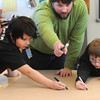 Ken Yuszkus/Staff photo: Danvers: Riverside School students Brayden Hosler, left, and Martin Fuller get directions from Jason Verhoosky who is instructing the 5th grade class to design a mural in preparation of the Rail Trail Mural being painted later this year.