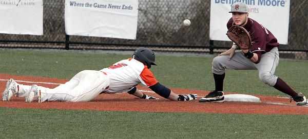 Ken Yuszkus/Staff photo: Salem:   Salem State University's Richard Fecteau gets back safely to 1st base as Rhode Island College's first baseman Tyler Santaniello waits for the throw from the pitcher in a pickoff try.