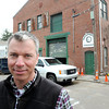 Ken Yuszkus/Staff photo: Salem:  David Pabich stands on Webster Street in front of the old electric trolley barn he is turning into housing.