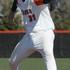 Ken Yuszkus/Staff photo: Salem: Salem State University pitcher Ryan Hyjek lets one fly while on the pitcher's mound during the Brandeis at Salem State University baseball game.